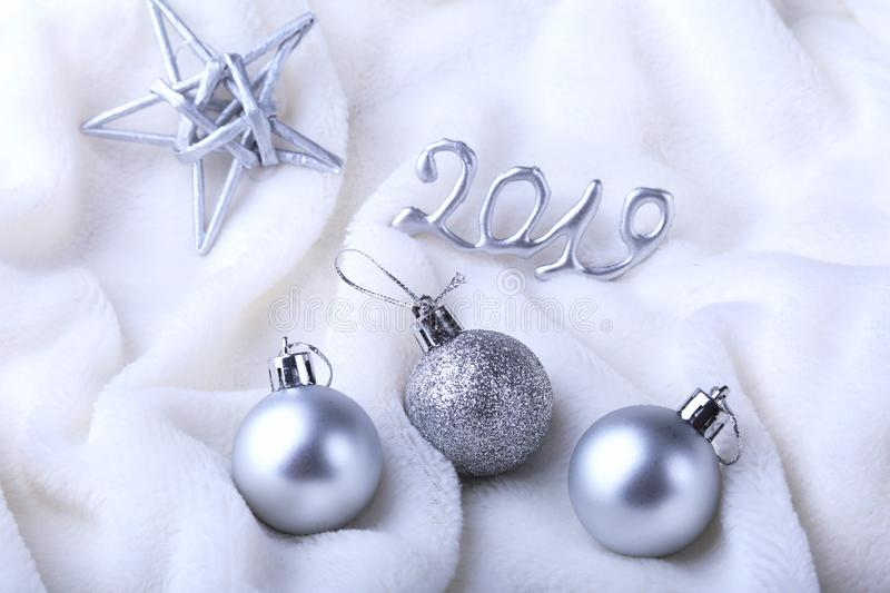 Silver gift box with ribbon bow and Christmas balls on white. Decoration for happy holidays. stock photos