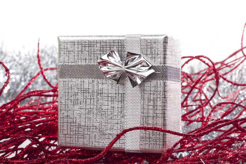 Silver gift in christmas decorations royalty free stock image