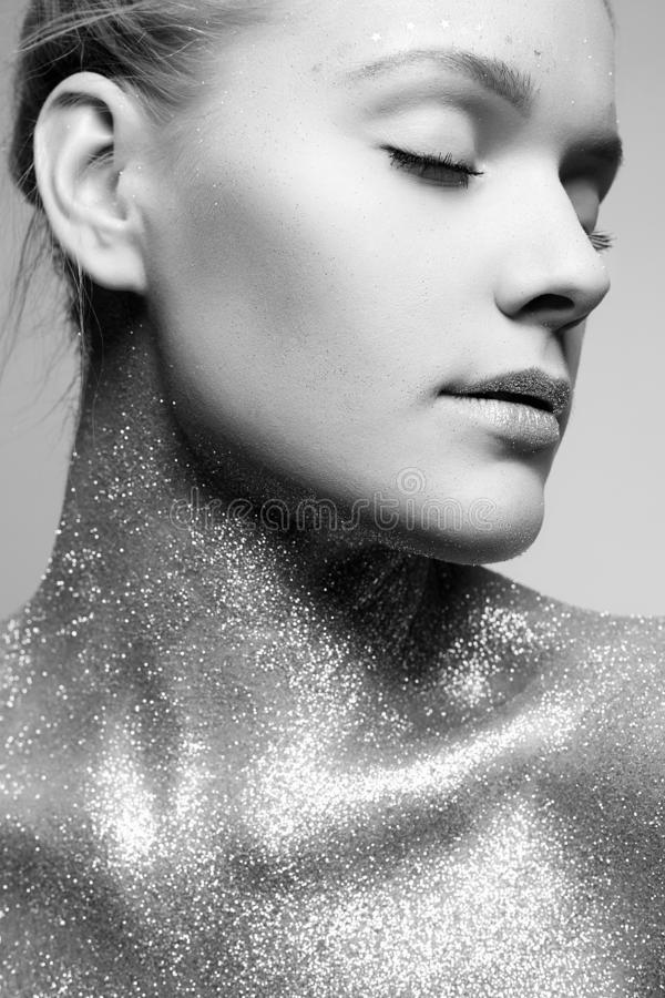Silver Girl. Beautiful Young Woman with Sparkles on her Body royalty free stock photo