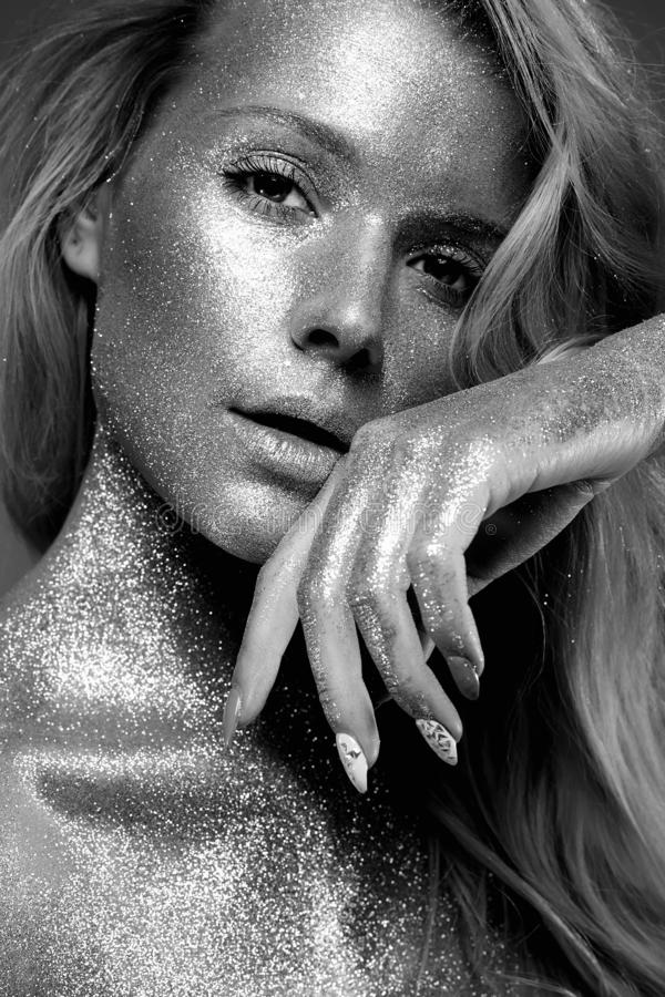 Silver Girl. Beautiful Young Woman with Sparkles royalty free stock photos
