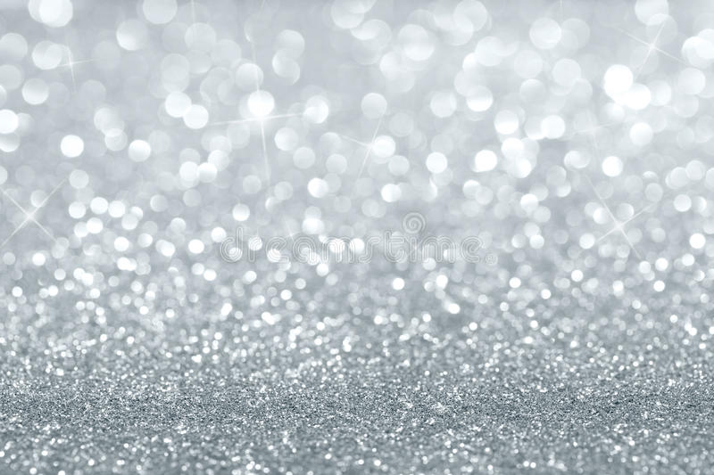 Silver glitter background. Abstract silver defocused glitter background with copy space