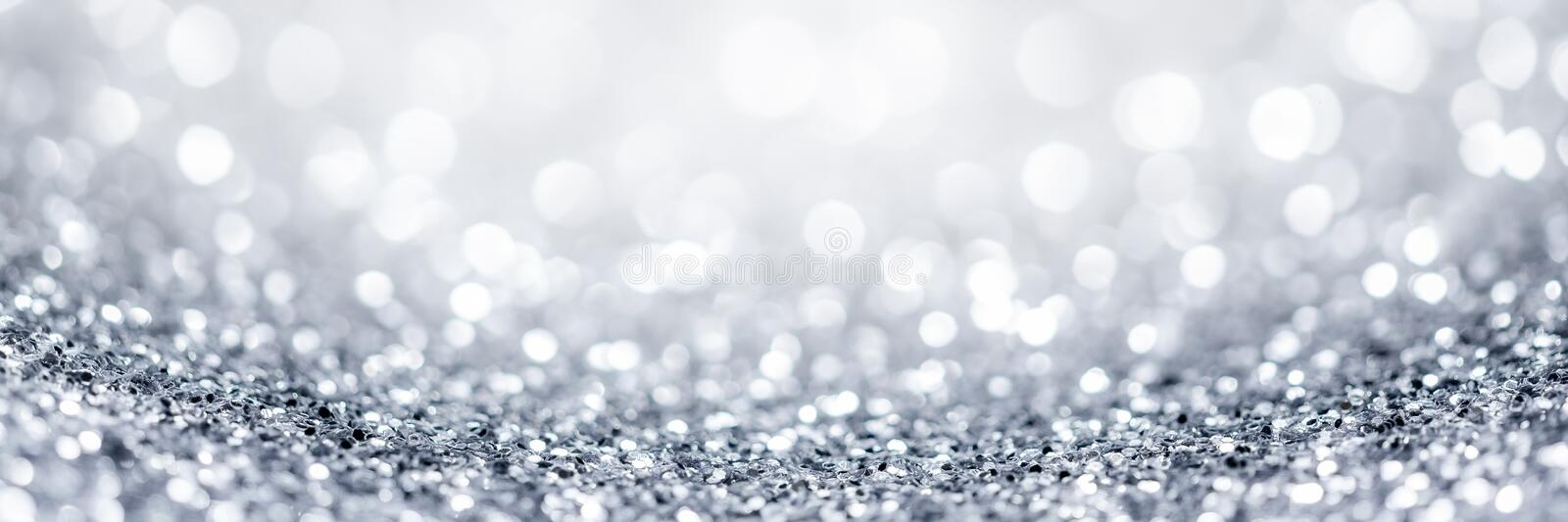 Silver Glitter Background. Abstract  Holiday Background With Silver Glitter And Bokeh Balls stock photography
