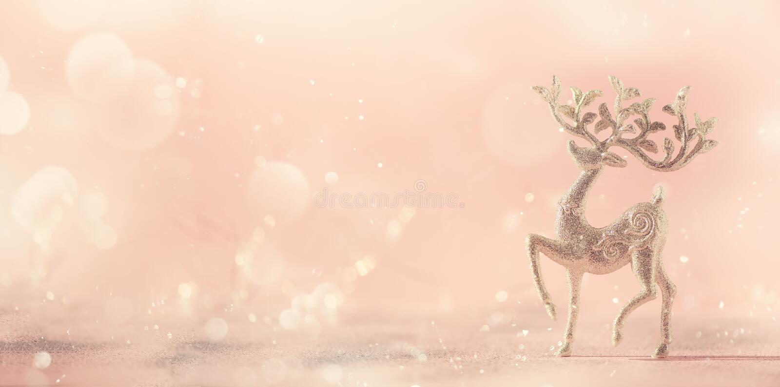 Silver glitter Christmas deer on pink background with lights bokeh, copy space. Greeting card for new year party. Festive holiday stock photography