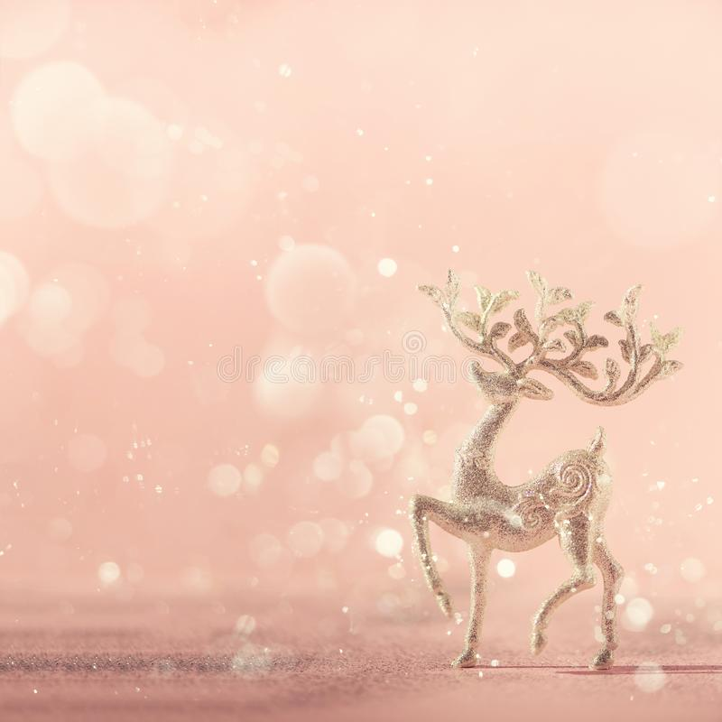 Silver glitter Christmas deer on pink background with lights bokeh, copy space. Greeting card for new year party. Festive holiday stock image