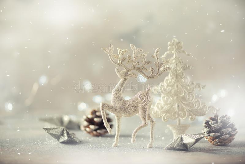 Silver glitter Christmas tree, deer, cones on grey background with lights bokeh, copy space. Greeting card for new year party. Festive holiday concept. Banner royalty free stock images