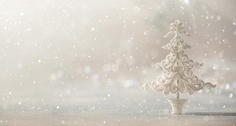 Silver glitter Christmas tree on grey background with lights bokeh, copy space. Greeting card for new year party. Festive holiday. Concept. Banner royalty free stock photos