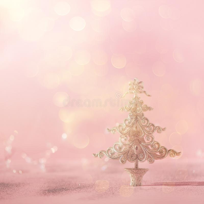 Silver glitter Christmas tree on pink background with lights bokeh, copy space. Greeting card for new year party. Festive holiday stock image