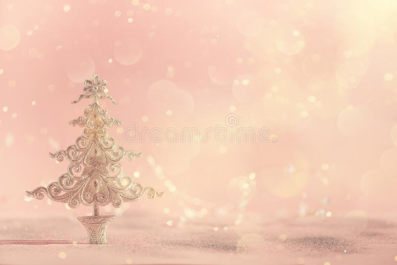 Silver glitter Christmas tree on pink background with lights bokeh, copy space. Greeting card for new year party. Festive holiday royalty free stock image