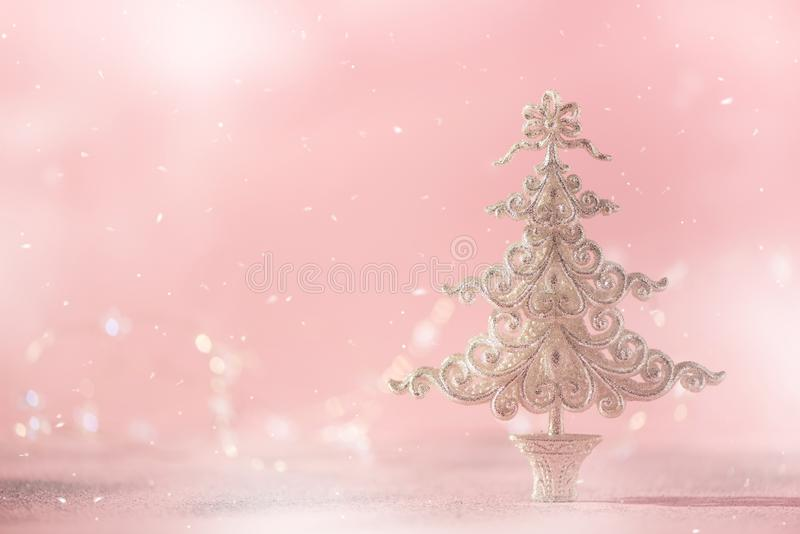 Silver glitter Christmas tree on pink background with lights bokeh, copy space. Greeting card for new year party. Festive holiday stock photos