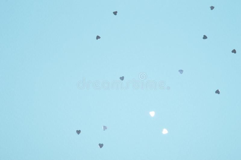 Silver glitter hearts on blue background in vintage colors stock images