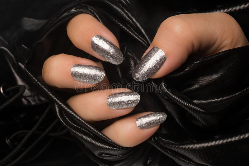 Silver glittered nails manicure royalty free stock photo
