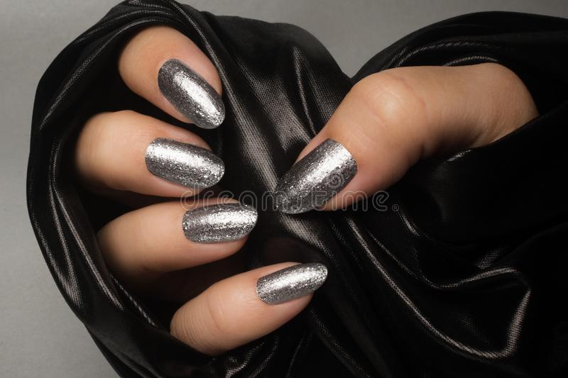 Silver glittered nails manicure royalty free stock photos
