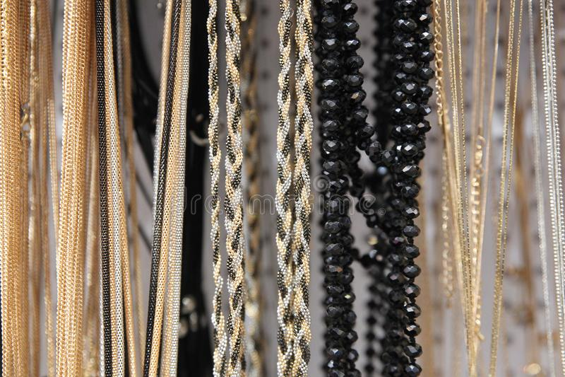Silver and gold chains of different thickness stock photography