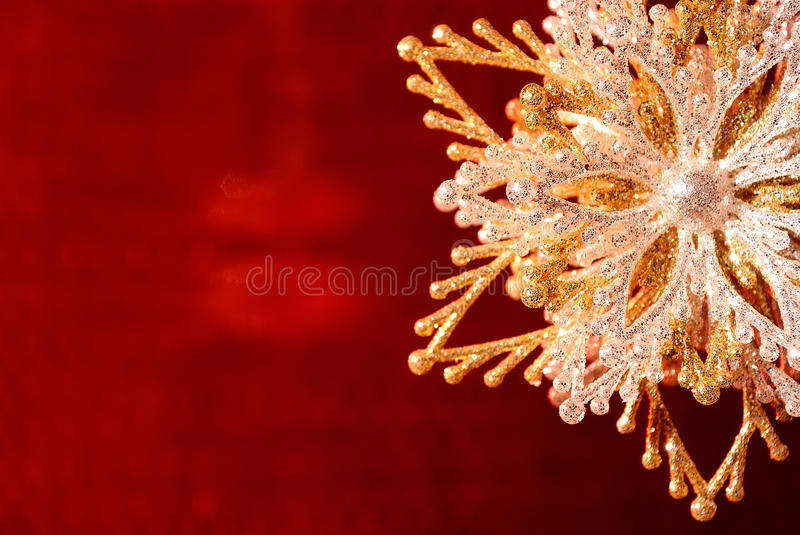 Download Silver-golden Snowflake On Red Royalty Free Stock Photography - Image: 17159597