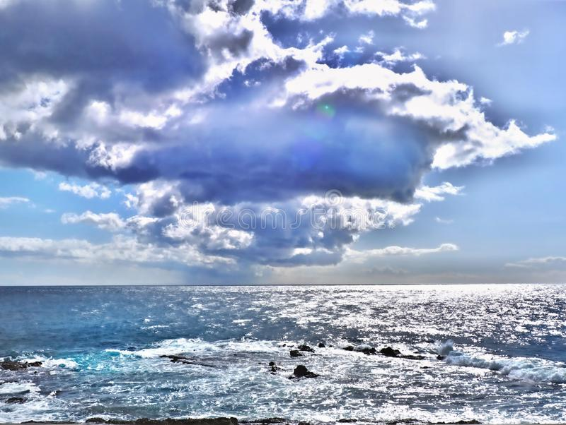 Silver-gray blue sea of clouds at the still azure sky above the Atlantic. Ocean at the blue hour on tenerife royalty free stock photo