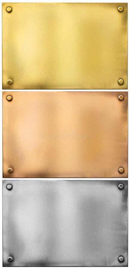 Silver guld, bronsmetallplattor med nitar ställde in arkivbilder
