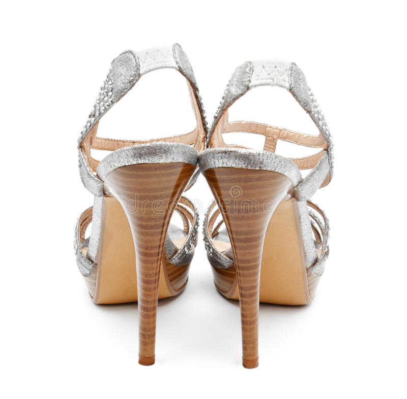 Silver high heel women shoe isolated. On white a background stock images