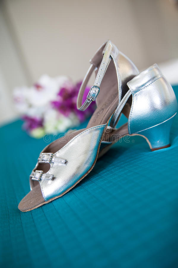 Silver high heeled shoes stock image