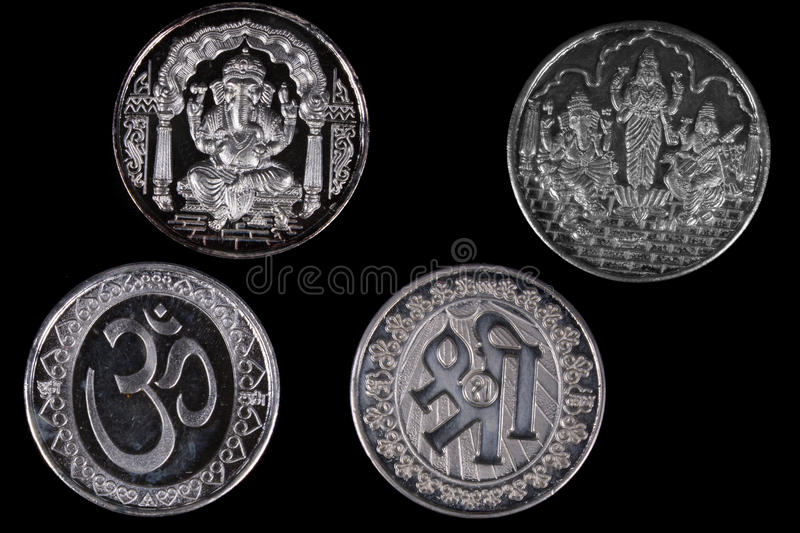 Silver Hindu Coins. Silver coins with designs of hindu religious symbols and gods for religious ceremonies royalty free stock images