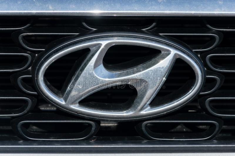 Silver Hyundai logo on car. Hyundai Motor Company is a South Korean multinational automotive manufacturer headquartered in Seoul. royalty free stock images