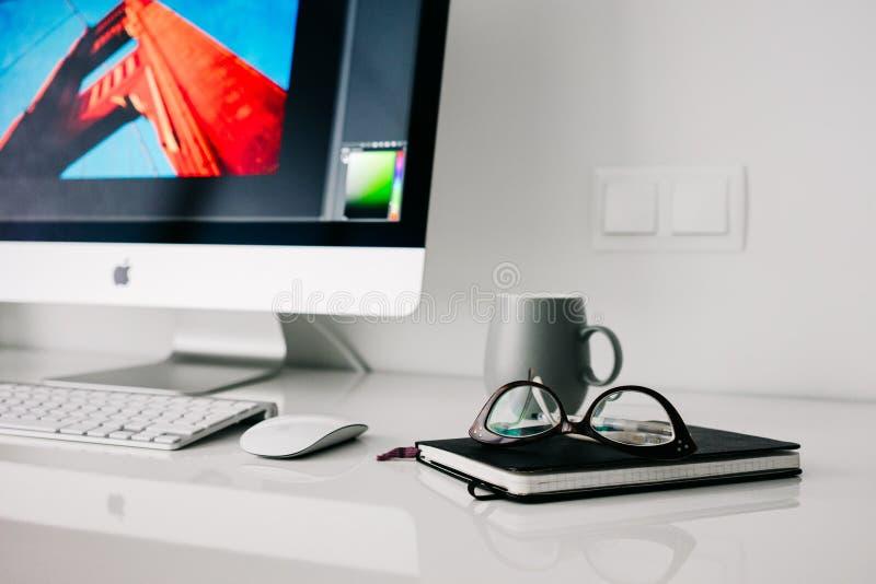 Silver Imac Turned On Beside Gray Ceramic Mug And Black Frame Eyeglasses Free Public Domain Cc0 Image
