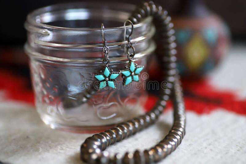 Silver Indian jewelry with turquoise, earring and necklace royalty free stock photo