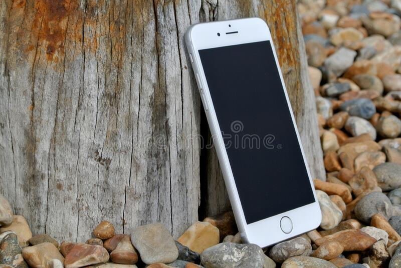 Silver Iphone 6 On Gray And Brown Stone Free Public Domain Cc0 Image