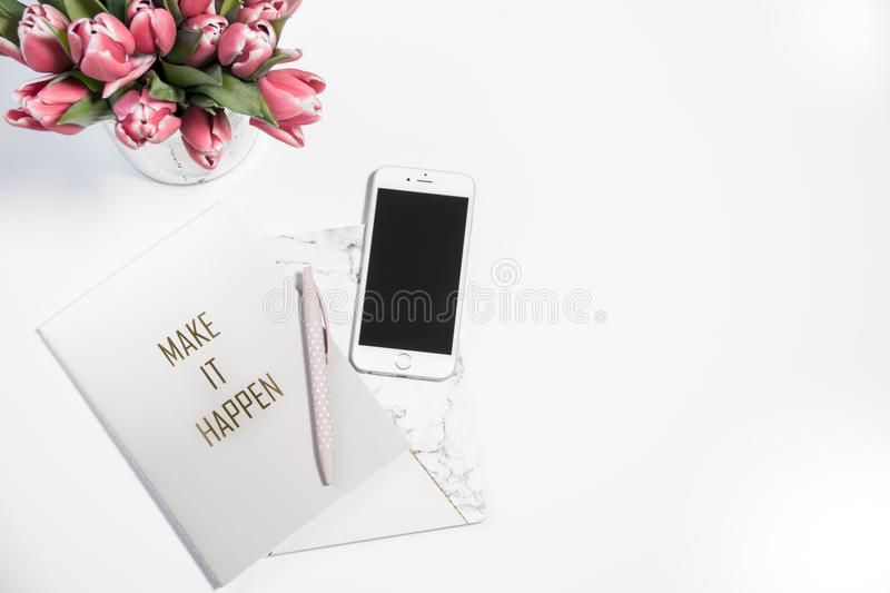 Silver Iphone 6 Beside Click Pen and Card stock photo
