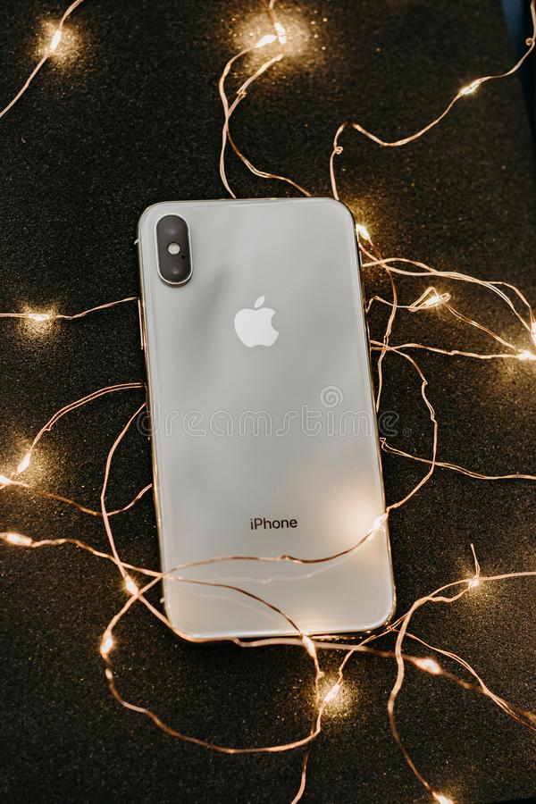 Silver Iphone X Lying On Pre-lit String Lights Free Public Domain Cc0 Image