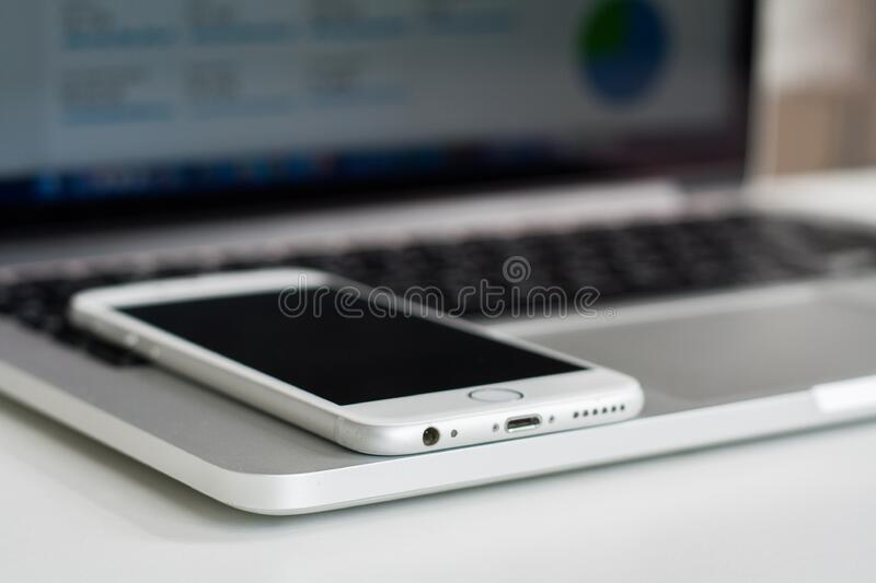 Silver Iphone 6 in Macbook Pro stock photo