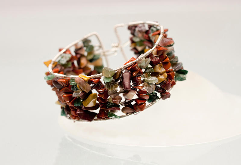 Silver jewels with colorful precious stones stock photo