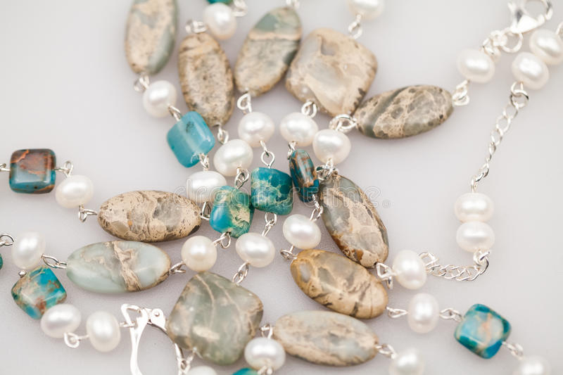 Silver jewels with colorful precious stones royalty free stock image