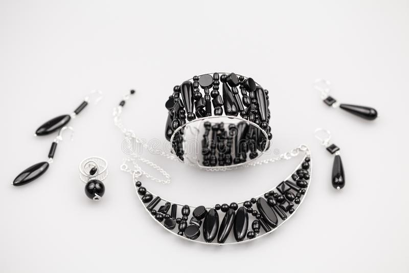 Silver jewels with onyx stones stock image