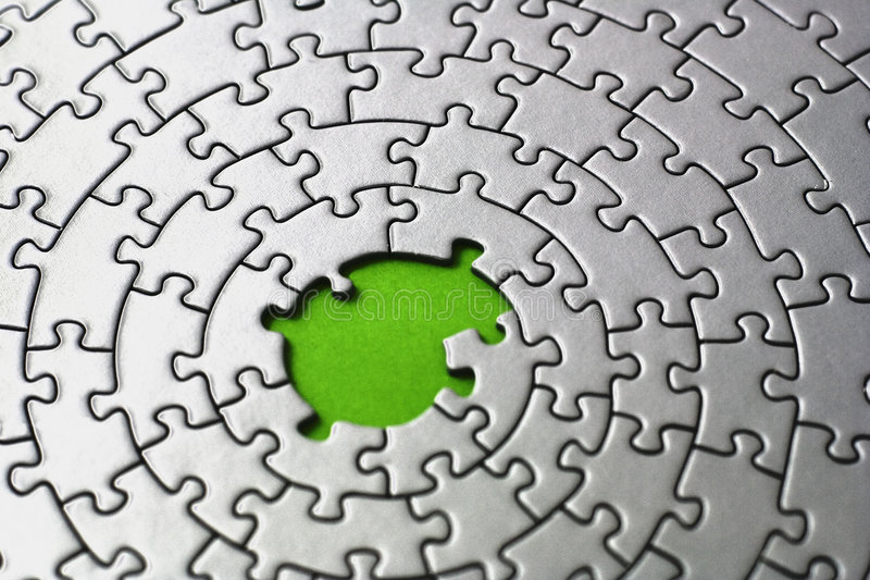 Silver jigsaw with missing pieces in the center. Shallow DOF, focus is on and over the missing pieces - adobe RGB stock photo