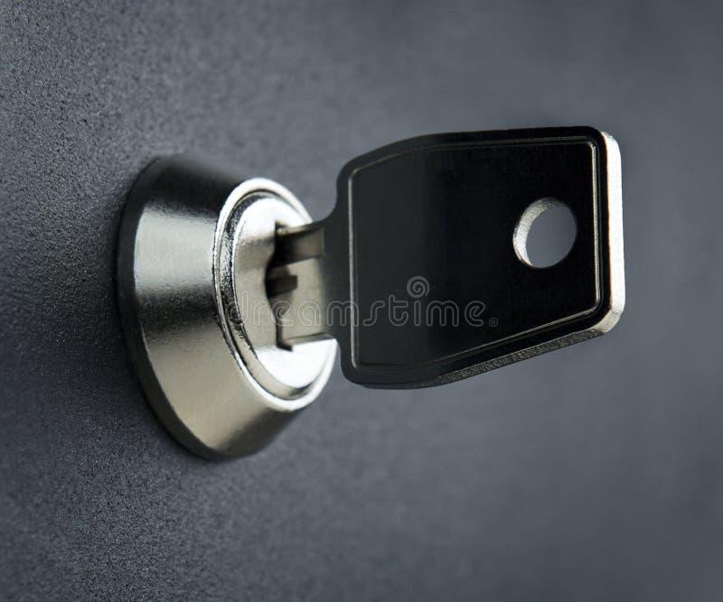 Silver key and lock royalty free stock photo