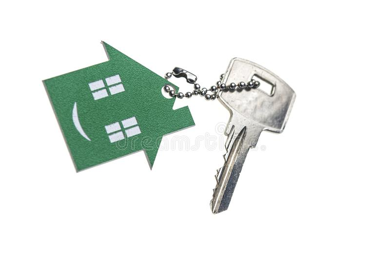 House shaped key-chain isolated on white background royalty free stock photos