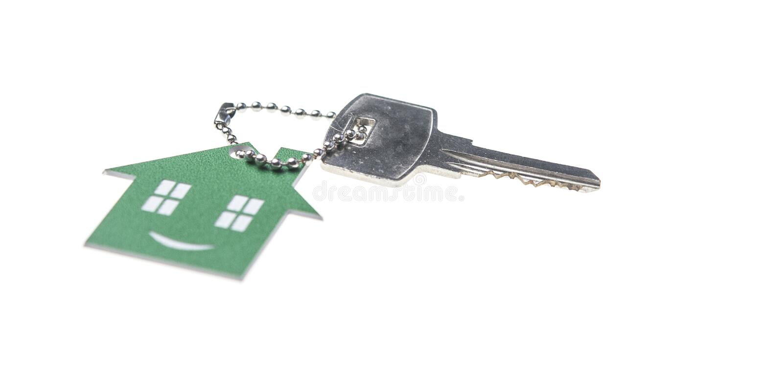 House shaped key-chain isolated on white background royalty free stock photography