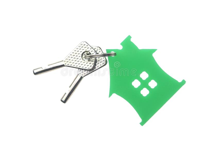 silver keys with house figure on the white background royalty free stock images