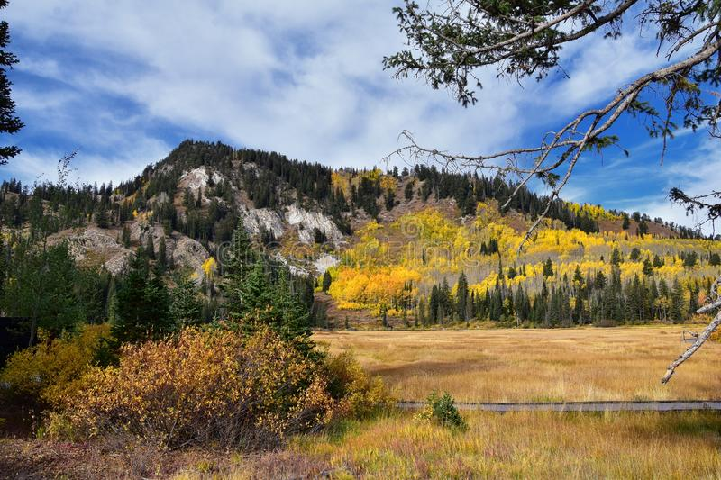 Silver Lake by Solitude and Brighton Ski resort in Big Cottonwood Canyon. Panoramic Views from the hiking and boardwalk trails of. The surrounding mountains royalty free stock photography