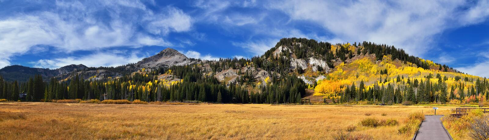 Silver Lake by Solitude and Brighton Ski resort in Big Cottonwood Canyon. Panoramic Views from the hiking and boardwalk trails of. The surrounding mountains stock images