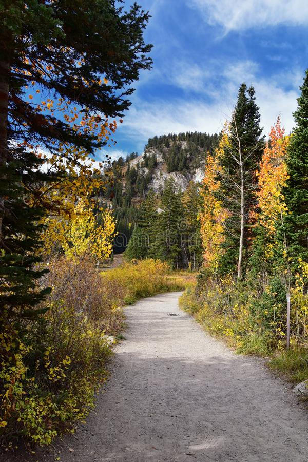 Silver Lake by Solitude and Brighton Ski resort in Big Cottonwood Canyon. Panoramic Views from the hiking and boardwalk trails of. The surrounding mountains royalty free stock images