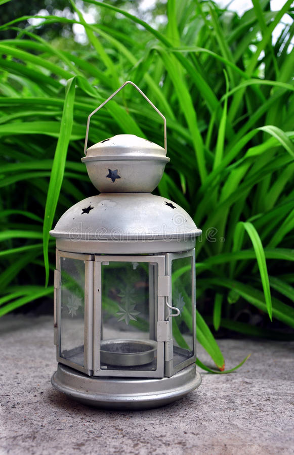 Silver lamp with candle stock photo