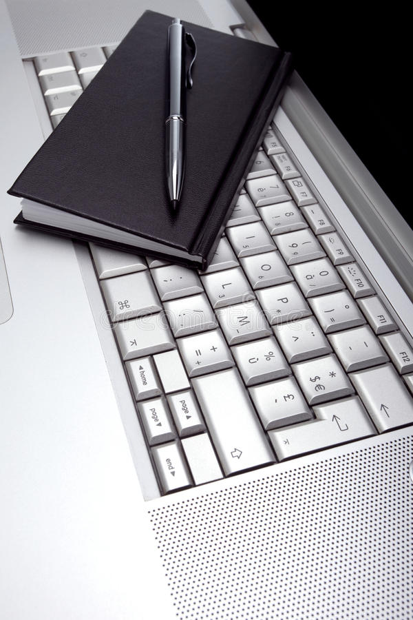 Silver lap top and black pocket planner vector illustration