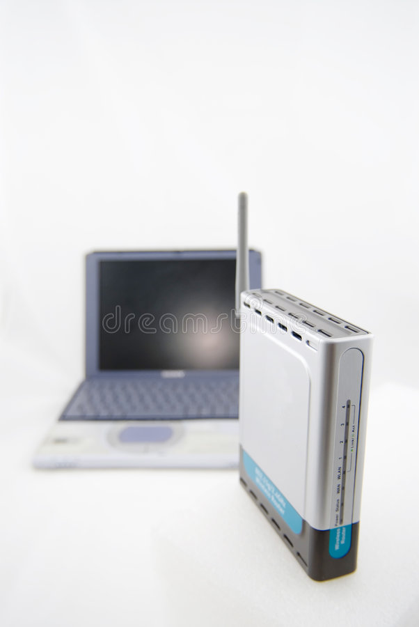 Silver Laptop and wireless router stock photography
