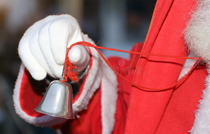 Silver little Bell from Santa Claus with white glove. Silver played little Bell from Santa Claus with white glove stock photos