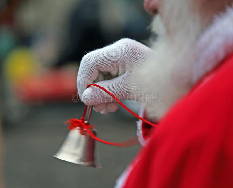 Silver little Bell from Santa Claus with white glove. Silver played little Bell from Santa Claus with white glove stock photo