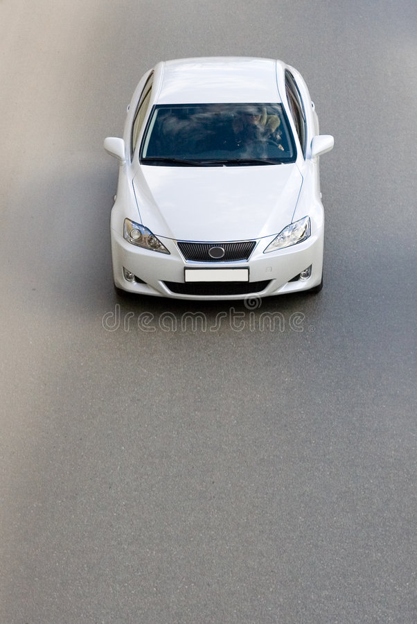 Silver luxury car driving fast. A silver luxury japanese car, driving fast royalty free stock photo