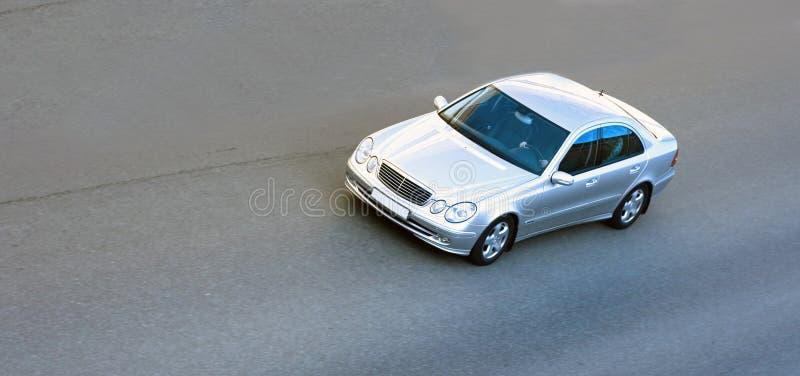 Silver luxury german car speed royalty free stock image