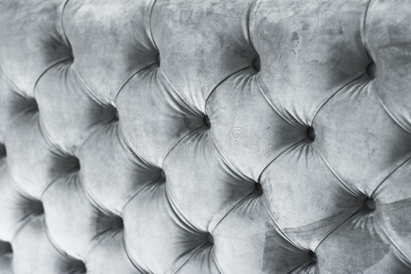 Silver luxury velour quilted sofa upholstery with buttons, elegant home decor texture and background. Furniture design, classic interior and royal vintage royalty free stock photography