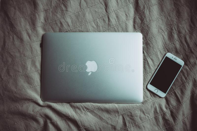 Silver Macbook Beside Silver Iphone 6 Free Public Domain Cc0 Image